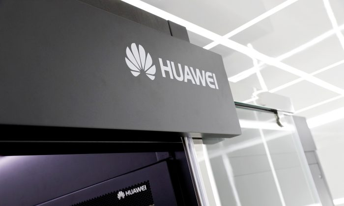 Logos of Huawei are seen on a device at its showroom in Shenzhen, Guangdong Province, China on March 29, 2019. (Tyrone Siu/Reuters)