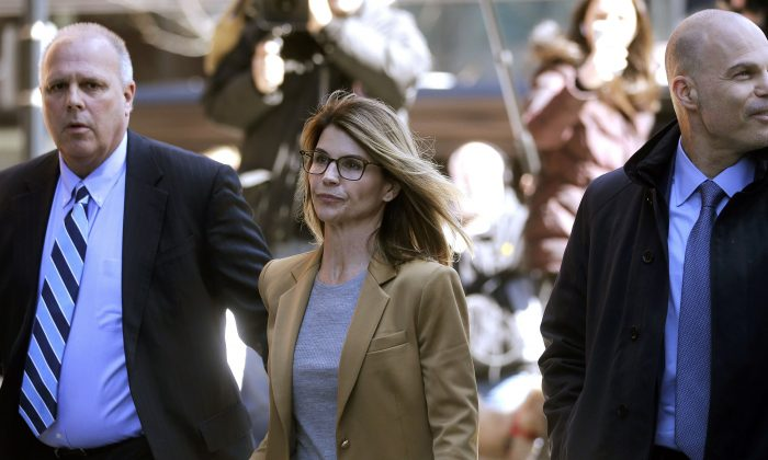 Actress Lori Loughlin arrives at federal court in Boston on April 3, 2019. (Charles Krupa/Photo via AP)