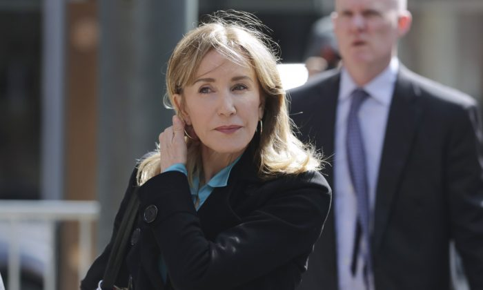 Actress Felicity Huffman arrives at federal court in Boston to face charges in a nationwide college admissions bribery scandal on April 3, 2019. (Charles Krupa/AP Photo)