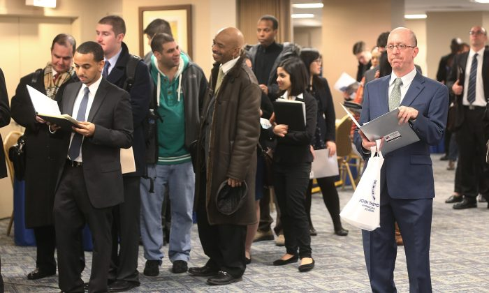 Applicants wait to meet potential employers at a Manhattan job fair in N.Y. on Jan. 17, 2013. (Mario Tama/Getty Images)
