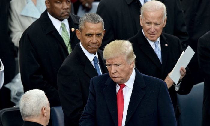 President Donald Trump (2nd-R) with Vice President Mike Pence (L) as former President Barack Obama and former Vice President Joe Biden (R) look on during Trump's inauguration ceremonies at the US Capitol in Washington, on Jan. 20, 2017. (Paul J. Richards/AFP/Getty Images)