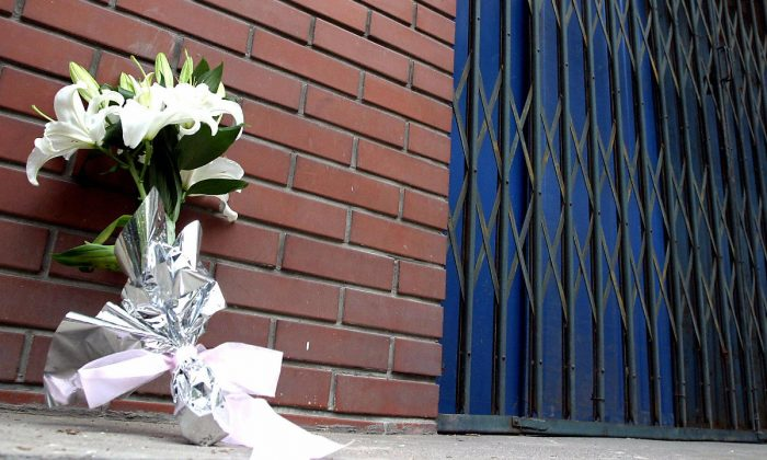 A bouquet of white flowers, a sign of mourning, outside a kindergarten in Beijing that suffered a knife attack. (STR/AFP/Getty Images)