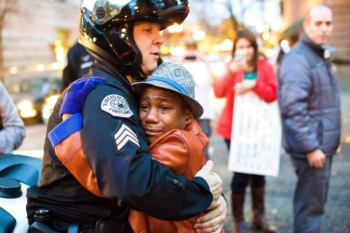 Portland police Sgt. Bret Barnum, left, and Devonte Hart