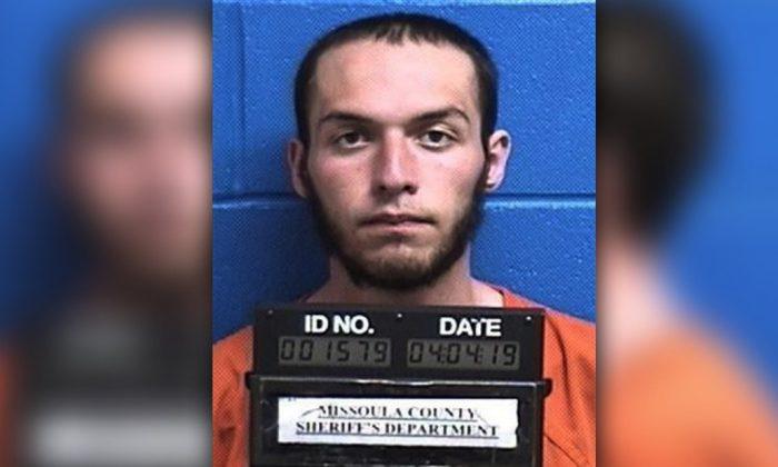 Fabjan Alameti, 21, is seen is in a booking photo taken on April 4, 2019. (Missoula County Sheriff's Office via AP)
