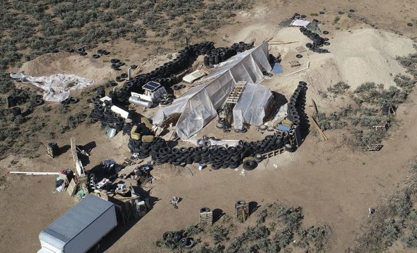 A ramshackle compound in the desert area of Amalia, N.M., on Aug. 10, 2018. A similar compound has been discovered in Alabama with links to the same group of accused terrorists. (Brian Skoloff/File via AP)
