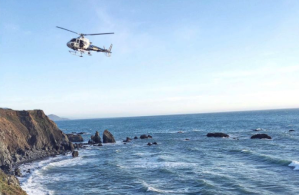 Stock photo of a helicopter hovering above water. (California Highway Patrol)