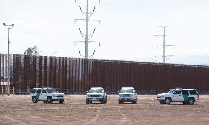 U.S. Customs and Border Patrol cars are seen near the border wall between the United States and Mexico in Calexico, Calif., on April 5, 2019. (Saul Loeb/AFP/Getty Images)
