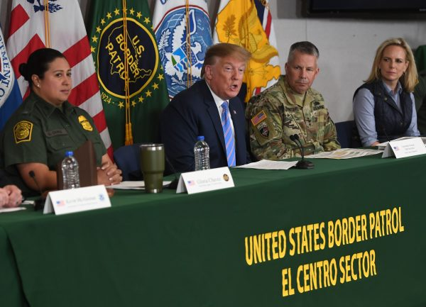 President Donald Trump (C) and Secretary of Homeland Security Kirstjen Nielsen (R) during a roundtable on immigration and border security at the Border Patrol Calexico Station in Calexico