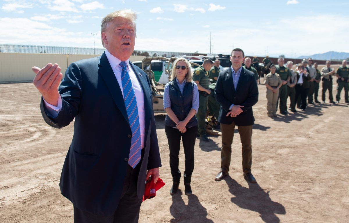 President Donald Trump speaks with members of the U.S. Customs and Border Patrol as he tours the border wall between the United States and Mexico in Calexico