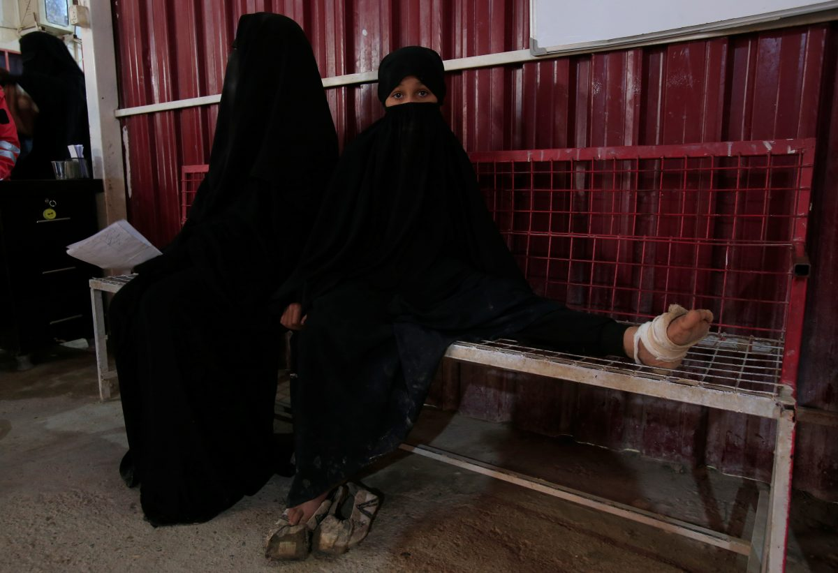 A wounded girl sits at a clinic at al-Hol displacement camp in Hasaka governorate
