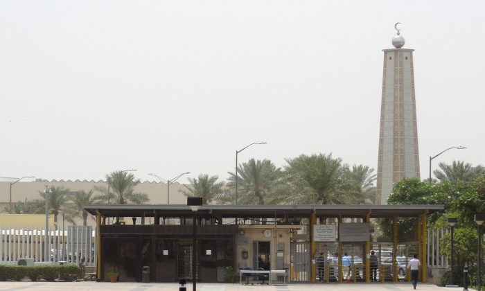 """A mosque is seen behind the entrance gate to the administration area of Saudi Aramco headquarters, on May 10, 2016 in Dhahran, 400kms east of the capital Riyadh. Despite collapsed global oil prices, production is expanding at Shaybah, as it is in other units of the company at the centre of the kingdom's Vision 2030 drive for diversification away from oil. The Saudi government plans to sell less than five percent of the company in what officials say will be the world's largest-ever share offering, while transforming Saudi Aramco into """"a global industrial conglomerate"""". By 2020 the company says it will have tripled its gas processing capacity from levels at the turn of the century.  / AFP / IAN TIMBERLAKE        (Photo credit should read IAN TIMBERLAKE/AFP/Getty Images)"""