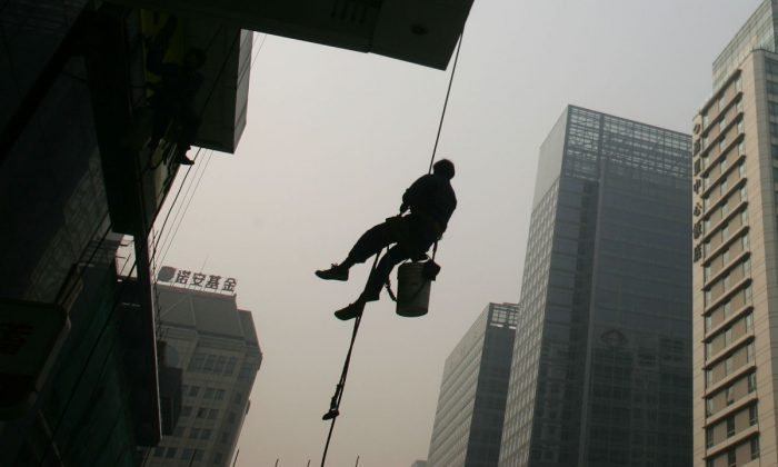 A window cleaner in Beijing, China. (China Photos/Getty Images)