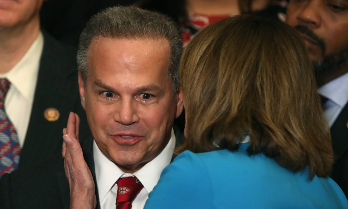 Rep. David N. Cicilline (D-R.I.) talks with House Speaker Nancy Pelosi (D-Calif.) during a news conference where House and Senate Democrats introduced the Equality Act of 2019 which would ban discrimination against lesbian, gay, bisexual and transgender people, in Washington on March 13, 2019. (Mark Wilson/Getty Images)