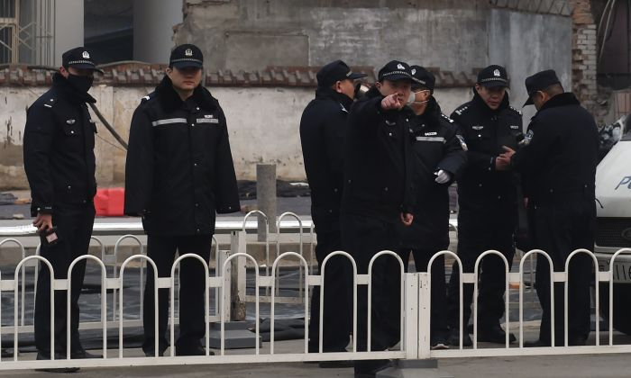 Police stand guard outside the No. 2 Intermediate People's Court where human rights lawyer Pu Zhiqiang was being sentenced in Beijing on December 22, 2015. (GREG BAKER/AFP/Getty Images)