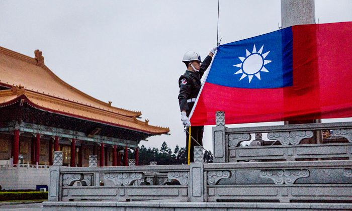 Honor guards prepare to raise the Taiwan flag in the Chiang Kai-shek Memorial Hall square ahead of the Taiwanese presidential election in Taipei, Taiwan, on Jan. 14, 2016. (Ulet Ifansasti/Getty Images)