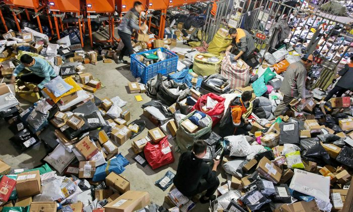 "Workers sort packages after the ""Singles Day"" online shopping festival at a delivery company in Nantong City, Jiangsu Province, China, on November 15, 2018. (STR/AFP/Getty Images)"