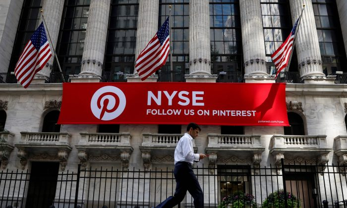 FILE PHOTO: A Pinterest banner hangs on the facade of the New York Stock Exchange (NYSE) in New York City, U.S., September 22, 2017. REUTERS/Brendan McDermid/File Photo