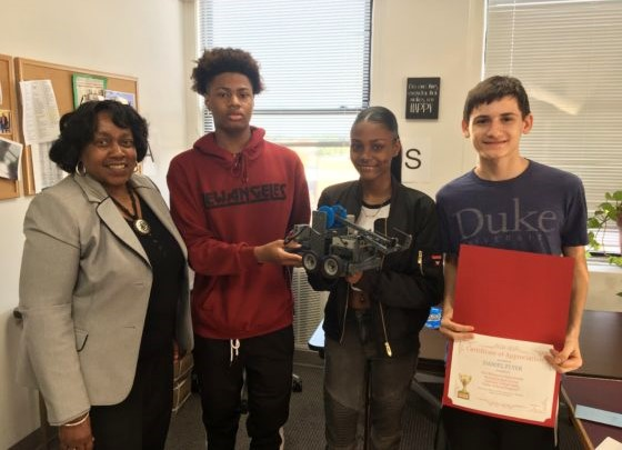 Daniel Flyer, far right, started a program to teach underprivileged children robotics at the Woman's Opportunity Rehabilitation Center in Hempstead, N.Y. (Photo by Karen Flyer)