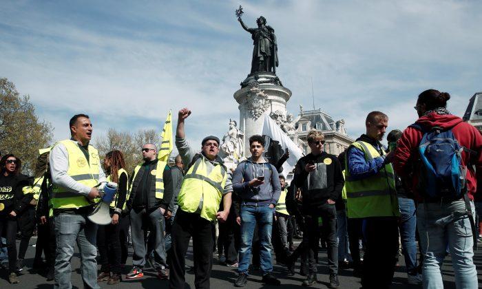 "Protesters wearing yellow vests attend a demonstration during the Act XXI (the 21st consecutive national protest on Saturday) of the ""yellow vests"" movement at Place de la Republique in Paris in Paris, France, April 6, 2019. REUTERS/Benoit Tessier"