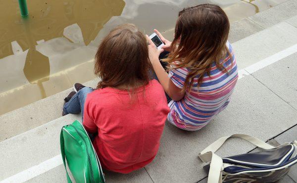 Girls discuss smartphone