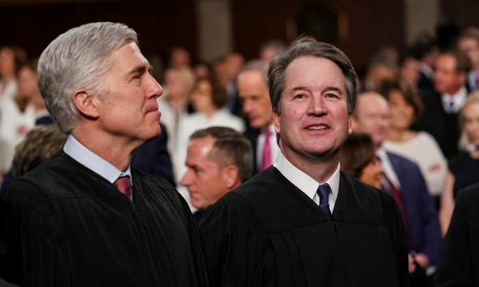 Supreme Court Justices Neil Gorsuch and Brett Kavanaugh attend the State of the Union address in the chamber of the U.S. House of Representatives at the U.S. Capitol Building on Feb. 5, 2019. Both men have sided with liberal justices in several cases since their appointments, using individual interpretation of the law as the basis of their judgements rather than politics. (Doug Mills-Pool/Getty Images)