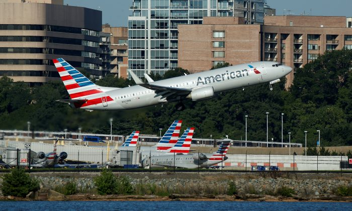 An American Airlines jet takes off from an airport in a file photograph from Aug. 9, 2017. (Joshua Roberts/Reuters)