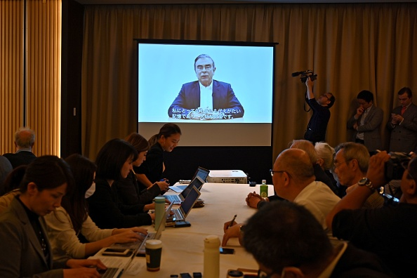 Journalists look on as lawyers for former Nissan chief Carlos Ghosn play a video message recorded by Ghosn before his most recent rearrest, during a press conference at the Foreign Correspondents' Club of Japan in Tokyo on April 9, 2019. CHARLY TRIBALLEAU/AFP/Getty Images