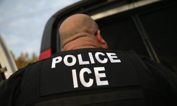 An Immigration and Customs Enforcement agent detains an illegal immigrant in a file photograph. (John Moore/Getty Images)