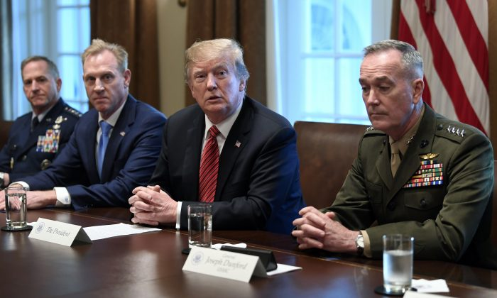 President Donald Trump, flanked by acting Defense Secretary Patrick Shanahan, second from left, and Chairman of the Joint Chiefs of Staff Gen. Joseph Dunford, right, speaks during a meeting with military leaders in the Cabinet Room of the White House in Washington, D.C. on April 3, 2019. At left is Air Force Chief of Staff Gen. David Goldfein. (Susan Walsh/AP)