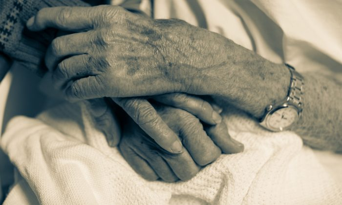People holding hands. (Illustration - Shutterstock)