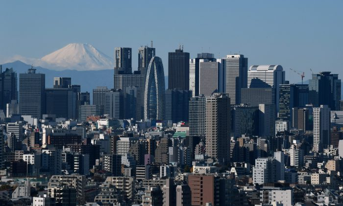 A snow-capped Mount Fuji (back L) in the distance, pictured from the observation deck of a skyscraper in Tokyo on Dec. 14, 2018. (Kazuhiro Nogi/AFP/Getty Images)