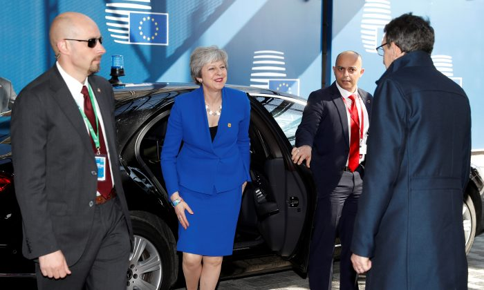 UK Prime Minister Theresa May arrives at a European Union emergency summit on Brexit in Brussels on April 10, 2019.   Alastair Grant/Pool via REUTERS