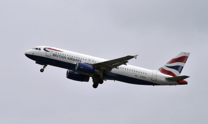 A British Airways airplane flies from the Toulouse-Blagnac airport, near Toulouse, France on Oct. 19, 2017. A recent British Airways flight from Singapore to London accidentally deployed oxygen masks mid-flight. (Pascal Pavani/AFP/Getty Images)