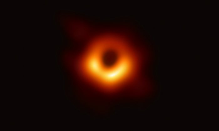 The first ever photograph of a black hole, released on April 10, 2019. (Event Horizon Telescope collaboration et al)