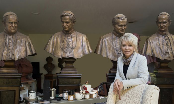 Carolyn D. Palmer with her sculptures of  four popes. (Erik Christian)
