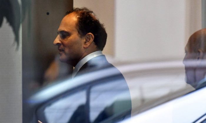David Sidoo, of Vancouver, Canada, enters an adjacent building with his lawyer following a federal court hearing , in Boston on March 15, 2019.  (Josh Reynolds/AP Photo)
