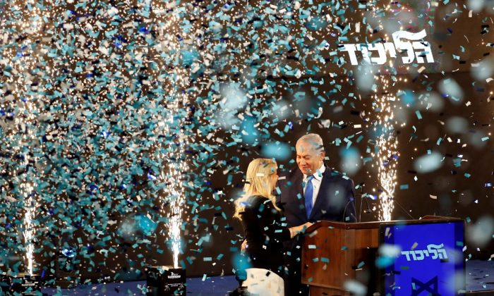 Confetti falls as Israeli Prime Minister Benjamin Netanyahu and his wife Sara stand on stage after Netanyahu spoke following the announcement of exit polls in Israel's parliamentary election at the party headquarters in Tel Aviv, Israel on April 10, 2019. (Ronen Zvulun/Reuters)