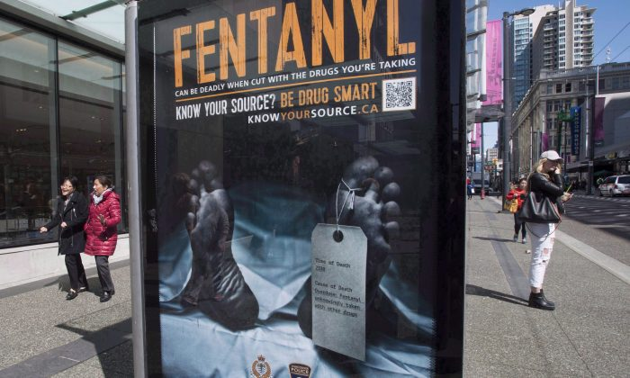 An anti-fentanyl advertisement is seen on a sidewalk in downtown Vancouver in this file photo. New government figures show that between January 2016 and September 2018, more than 10,300 Canadians died from apparent opioid overdoses, with men the most likely victims and fentanyl the primary culprit. (The Canadian Press/Jonathan Hayward)