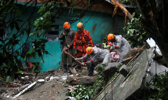 Firefighters work at the site of a mudslide after a heavy rain at the Babilonia slum in Rio de Janeiro, Brazil, April 9, 2019. (Reuters/Pilar Olivares)