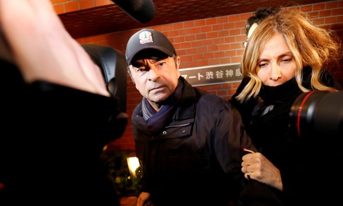 Former Nissan Chairman Carlos Ghosn accompanied by his wife, Carole, in Tokyo on March 8, 2019. (Issei Kato/Reuters)