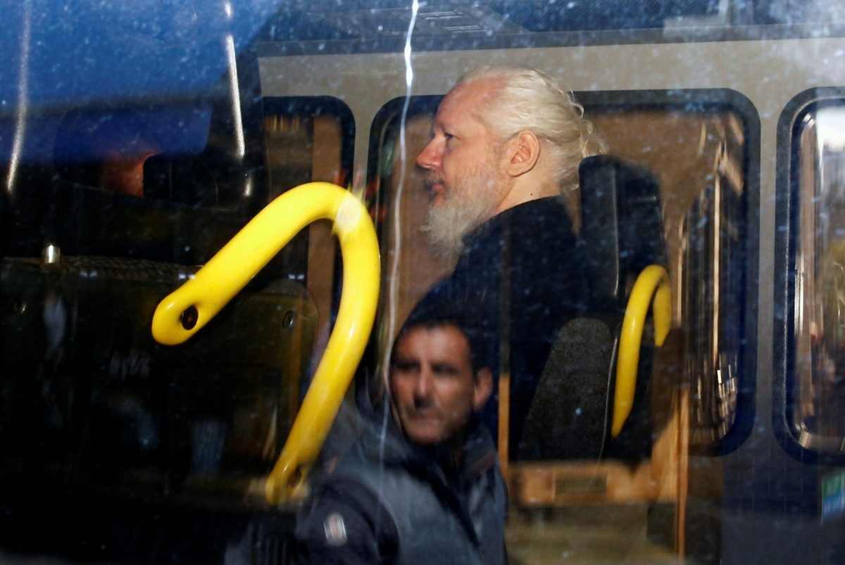 WikiLeaks founder Julian Assange is seen in a police van in London