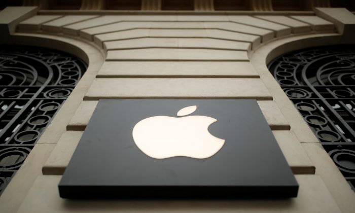 The Apple logo company outside an Apple store in Paris on April 10, 2019. (Christian Hartmann/Reuters)