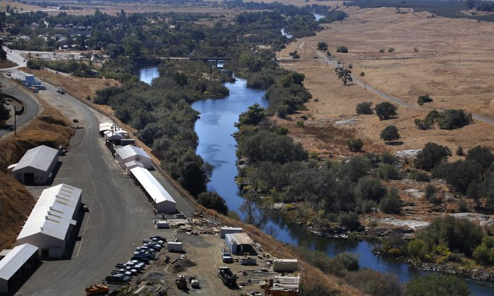 The first leg of the San Joaquin River restoration project during a tour in Friant, Calif., on Oct. 5, 2016. The Sacramento Sheriff's Department said the river was flowing quickly due to heavy rainfall and runoff on March 29, 2019. (Gary Kazanjian/AP Photo)