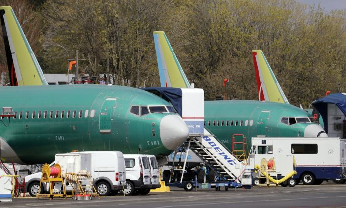 Boeing 737 Max 8 jets, built for American Airlines, left, and Air Canada are parked at the airport adjacent to a Boeing Co. production facility in Renton, Wash. on April 8, 2019. (Elaine Thompson/File photo via AP)