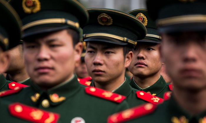 People's Liberation Army soldiers participate in a ceremony in this file photo. (Chandan Khanna/AFP/Getty Images)