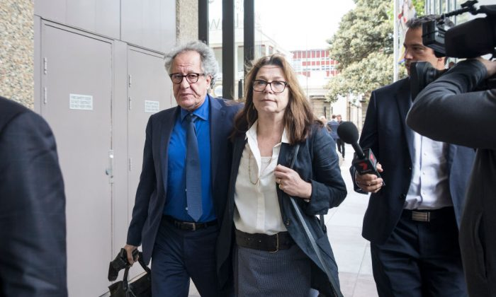 Geoffrey Rush leaves court with his wife Jane Menelaus on November 9, 2018 in Sydney, Australia.  Geoffrey Rush is suing The Daily Telegraph for defamation over a series of articles that were published in late November and early December 2017 that alleged he behaved inappropriate during a 2015 stage production of King Lear. (Jessica Hromas/Getty Images)