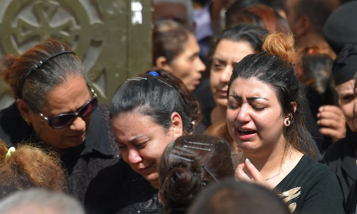 Coptic Christian women mourn victims killed in an attack a day earlier, as the coffins are carried out of the Prince Tadros church in Egypt's southern Minya province,following a morning ceremony on November 3, 2018. MOHAMED EL-SHAHED/AFP/Getty Images