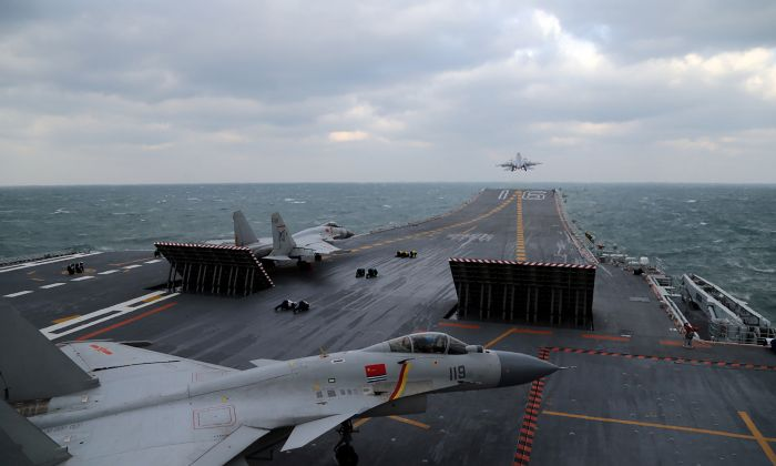 Chinese J-15 fighter jets being launched from the deck of the Liaoning aircraft carrier during military drills in the Yellow Sea, off China's east coast on December 23, 2016. (STR/AFP/Getty Images)