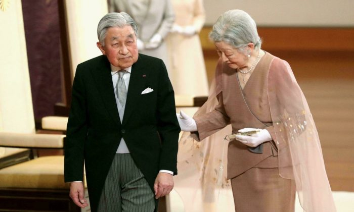 Japan's Emperor Akihito, left, and Empress Michiko, right, leave after the celebration ceremony of their 60th wedding anniversary at the Imperial Palace in Tokyo, on April 10, 2019. (Kyodo News via AP)