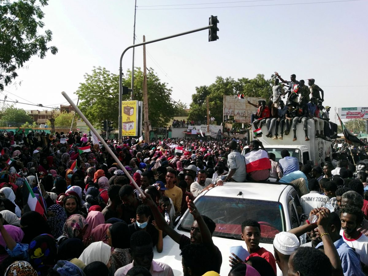Sudanese demonstrators gather in a street